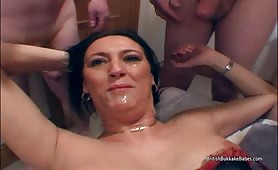 Mature takes facials with her fat busty friend